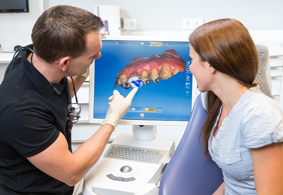 Dentist and patient looking at CEREC design
