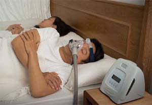 Sleeping man with CPAP mask